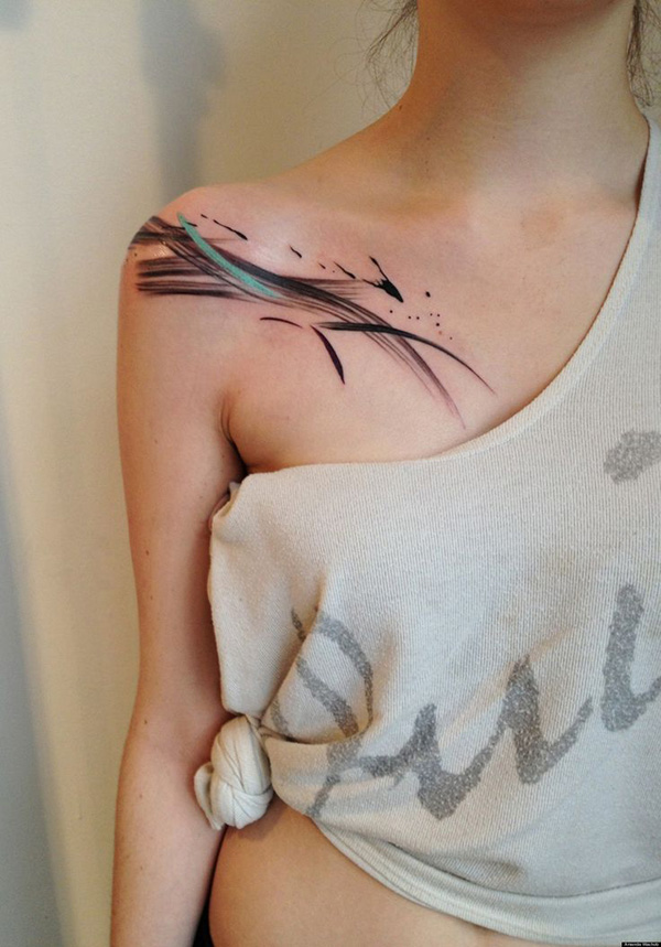 Abstract Clavicle Tattoo With Black Ink For Woman