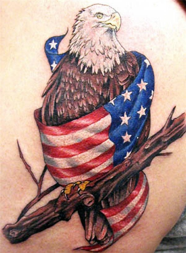 Amazing Eagle Sitting On Tree With American Flag Tattoo On Back