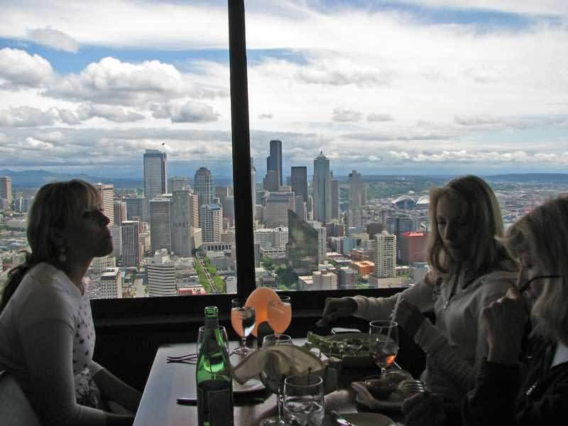 Beautiful Womens Enjoying Food And Beverages At Restaurant Inside Space Needle Photo