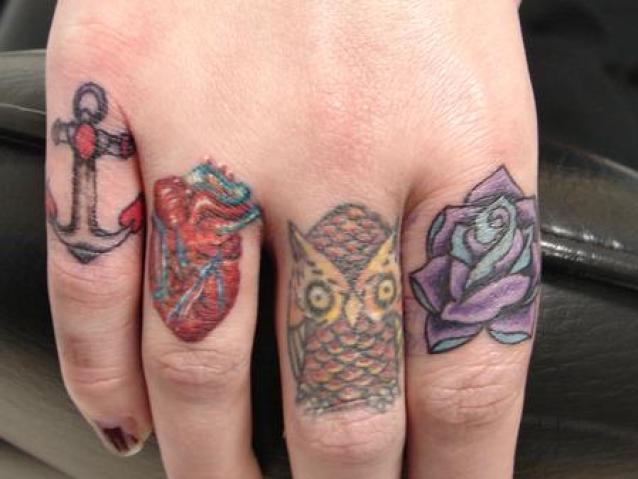 Colorful Ink Baby Owl Anchor Heart Purple Rose Knuckle Tattoo Design On All Fingers
