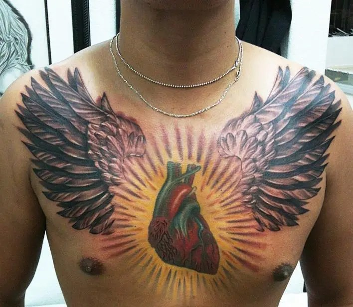 Famous Red Black And Yellow Color Ink Heart 3d Tattoo On Boy's Chest