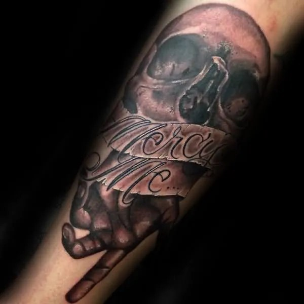 Horrible Grey Ink Skull And Mercy Me Banner Tattoo Design For Men Forearm