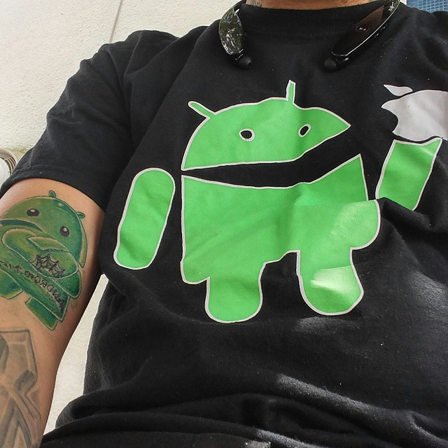 Most Amazing Android Cartoon Tattoo Design On Men Sleeve