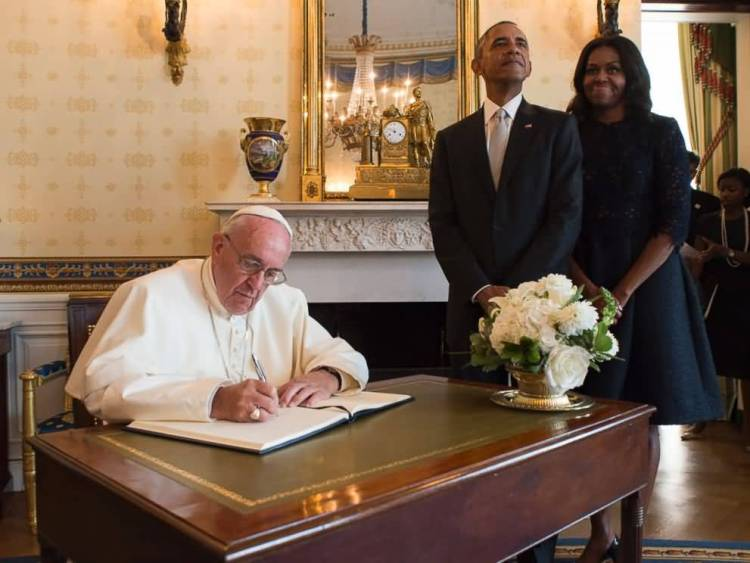 Obama With His Wife Inside The White House For Pope Francis Signs A Book Barack