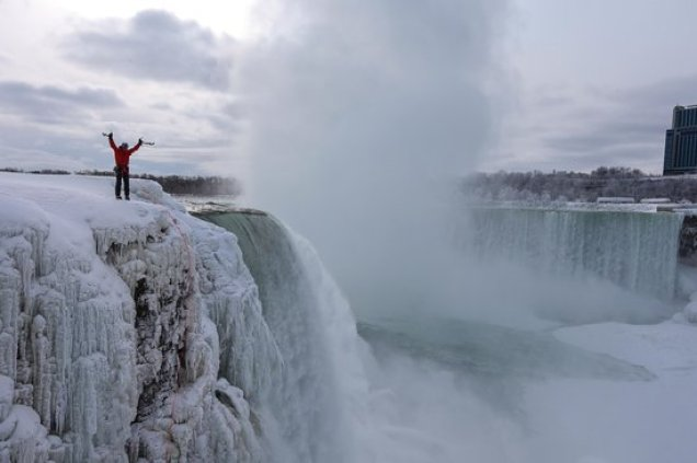One Brave Person On The Top Of Frozen Niagara Falls Photo For Wallpaper