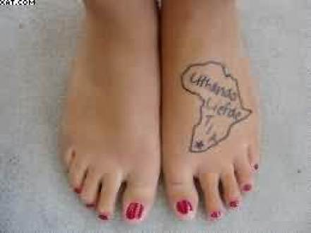 Superb Grey Color INk African Outline Map Wording Tattoo On Girl's Foot Made By Expert