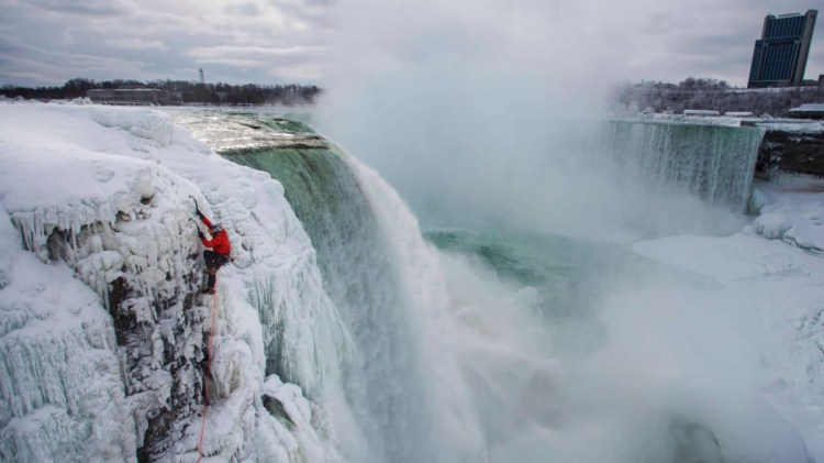 Up Side Of Frozen Niagara Falls With One Brave Person