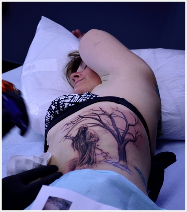 Women Get Her New Grim Reaper Dry Tree Ribs Side Tattoo Design