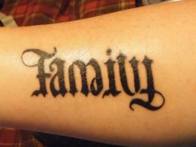adorable black color ink ambigram two word tattoo of family for boys and girls made by expert