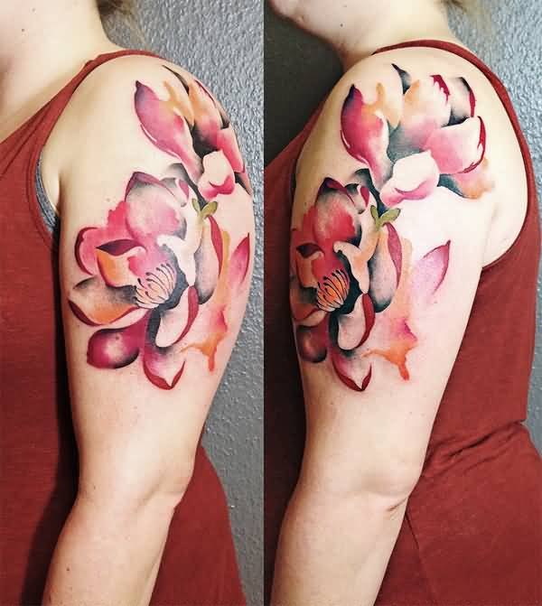 amazing magnolia flower tattoo on arm With colourful ink For Man And Woman