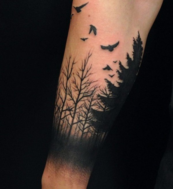 attractive forest and birds tattoo on wrist With Black ink For Man And Woman