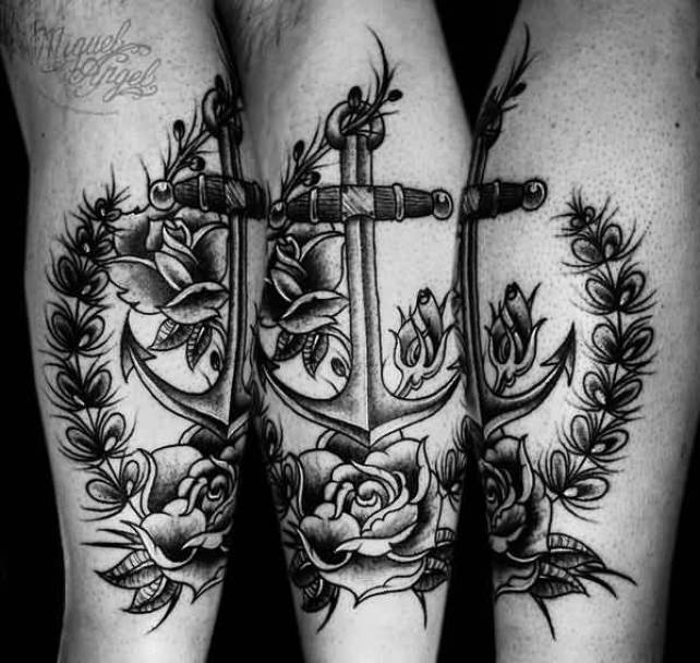awesome black color ink anchor tattoo on boy leg for boys made by expert