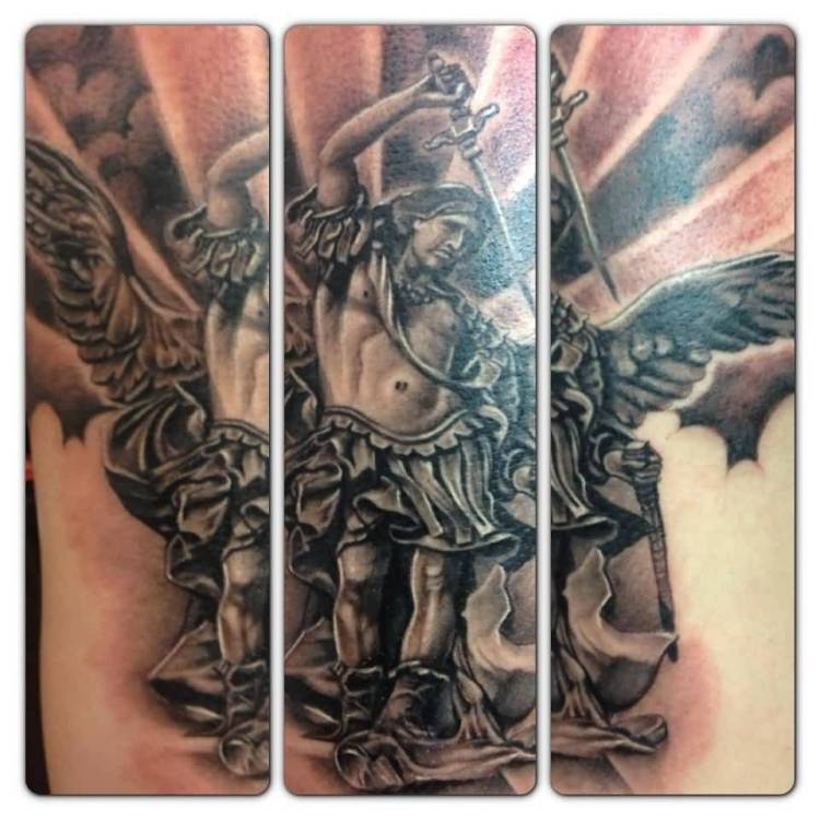 awesome black color ink angel warrior tattoo on boy's shoulder for boys only made by expert artist