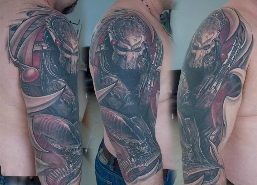 awesome red and gray color ink Predator Tattoo On Ripped Skin for boys