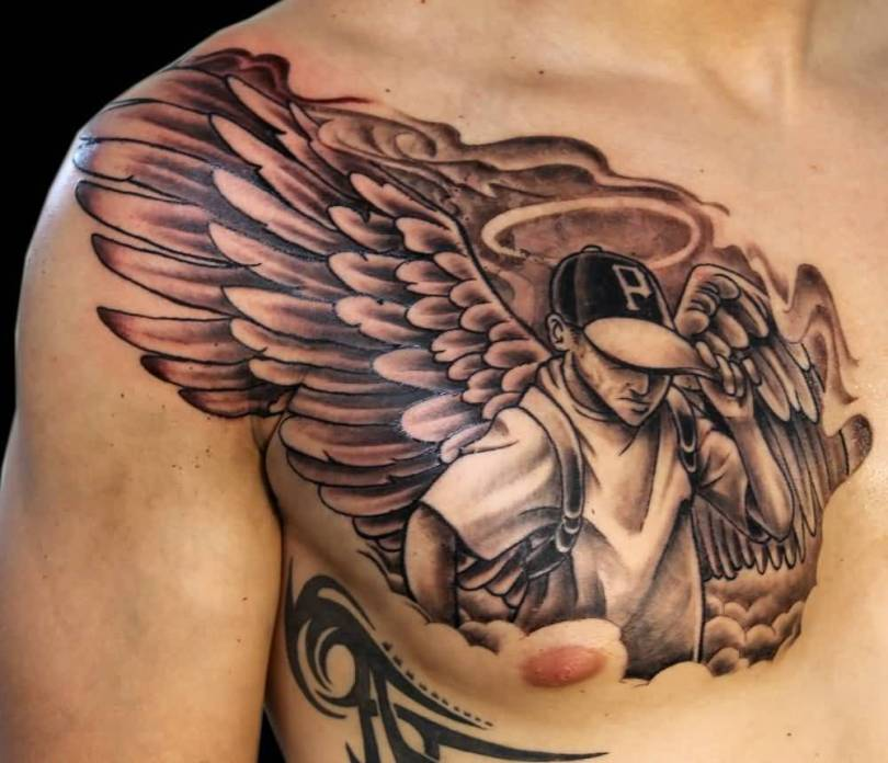 awesome red and gray color ink angel tattoo on boy chest for boys made by expert artist Angel Chest Tattoo
