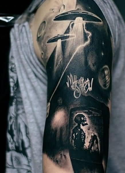 cool black color ink Ufo And Skeleton Tattoo Made By Expert on boy shoulder
