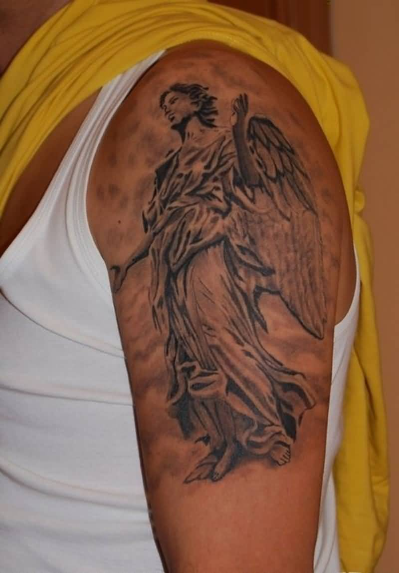 cool red light and gray color ink angel tattoo on boy sleeve for boys made by expert artist