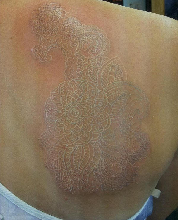 coolest White ink lace tattoo on back With white ink For Man And Woman