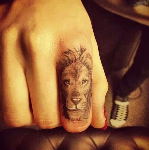 Coolest Lion Finger Tattoo With Black Ink For Man And Woman