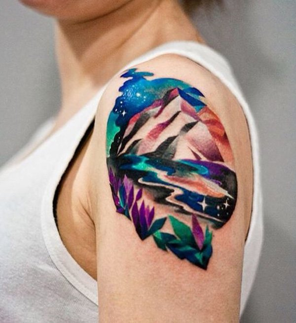 coolest mountain tattoo on arm With colourful ink For Man And Woman