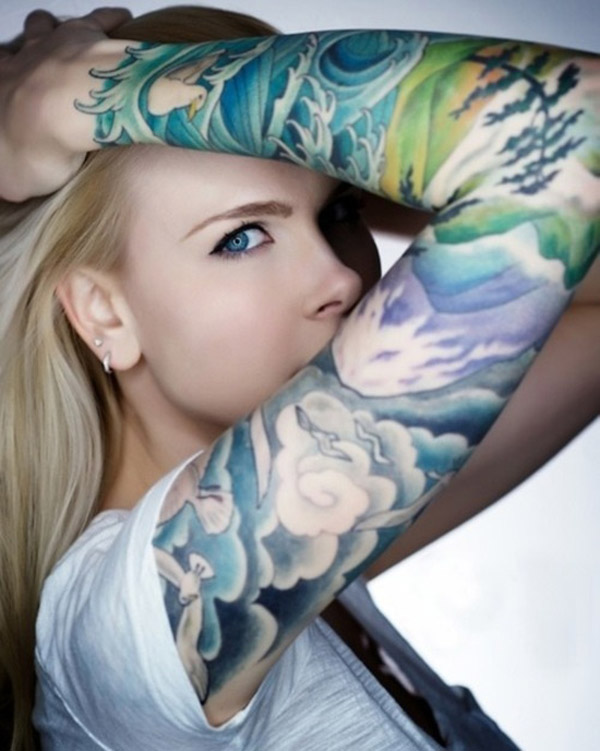 Cute Cloud Tattooed On Arm On Back With Colourful Ink For Women