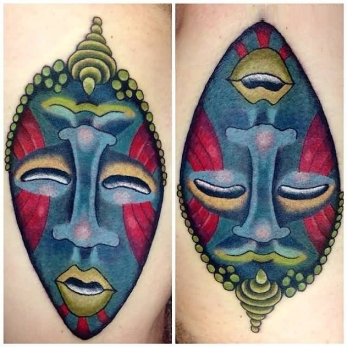 Cute Red And Blue African Mask Tattoo For Man
