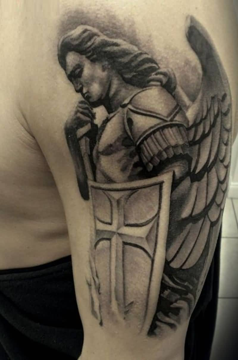elegant black color ink angel warrior tattoo on boy's full shoulder for boys only made by expert artist