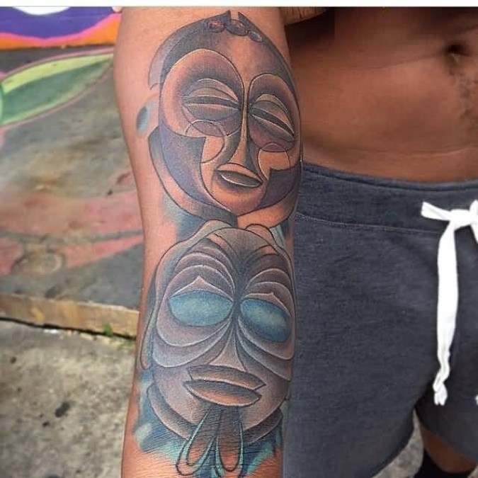Extremely Gray And Red Light Color Ink And Rare African Mask Tatto For Man