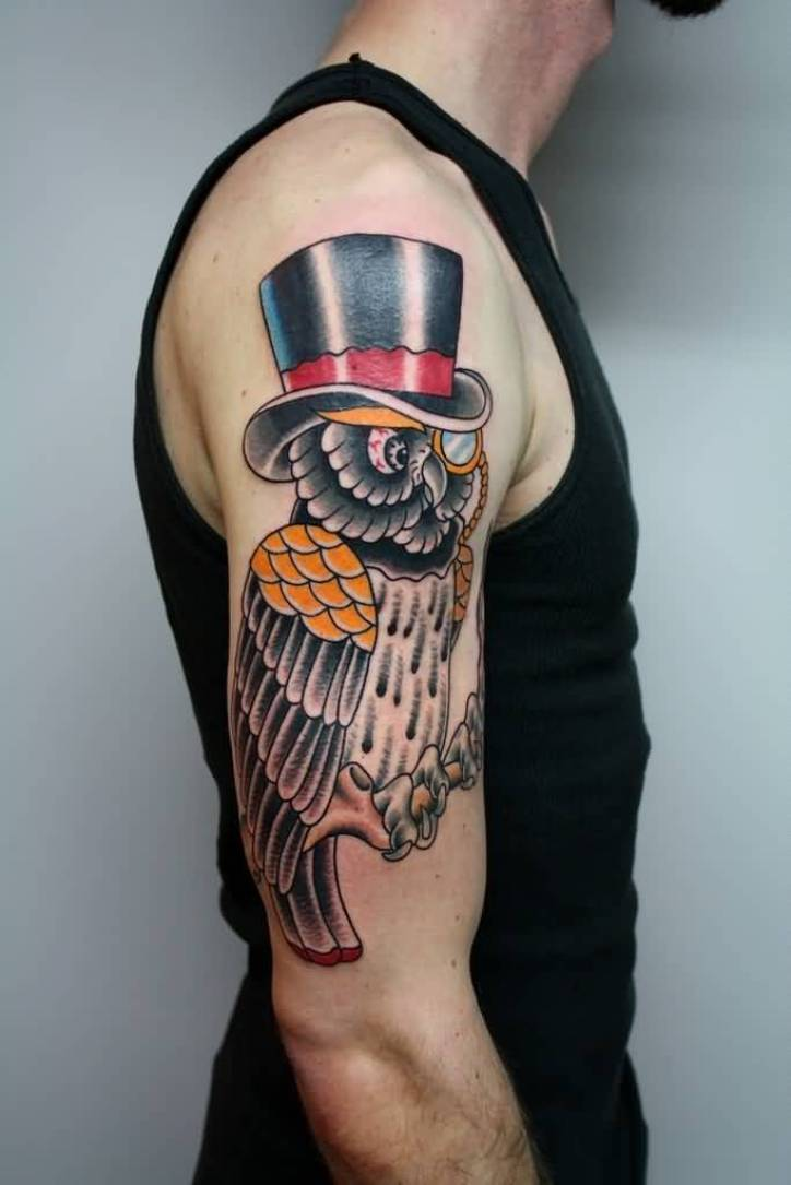extremely red yellow and black color ink animated owl tattoo on boy's sleeve for boys only made by expert artist