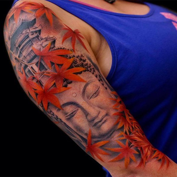 Eye Catching Buddha And Maple Leaves Tattoo With Colourful Ink For Woman Man