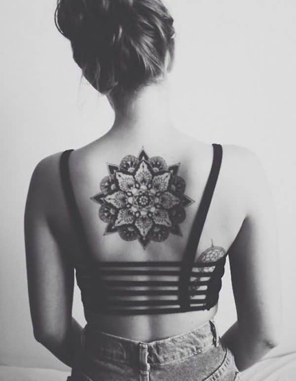 Eye Catching Mandala Back Tattoo For Girl With Black Ink