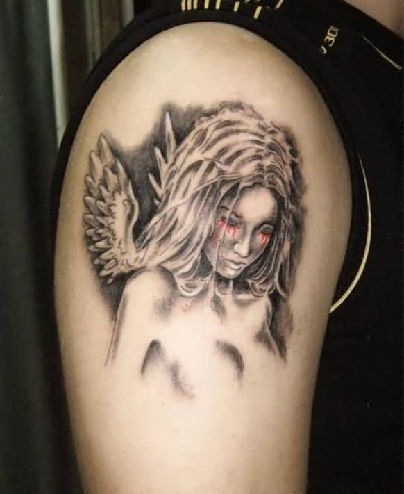 famous black and red color ink angel tattoo on boy sleeve for man made by expert