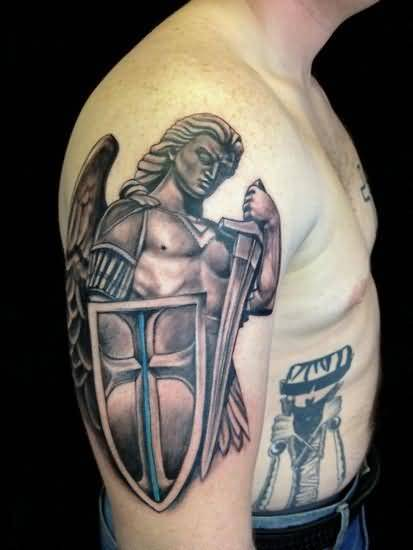 famous gray and blue color ink angel warrior tattoo on boy's shoulder for boys made by expert
