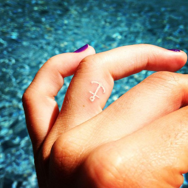 Fantastic White Ink Anchor Finger Tattoo With Black Ink For Man And Woman