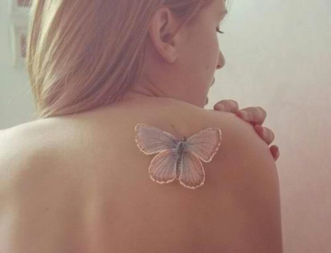 fantastic White ink butterfly tattoo on back white ink For Man And Woman