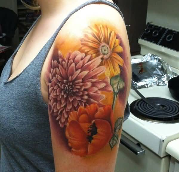 gorgeous chrysanthemum tattoo on arm with colourful ink for man & woman