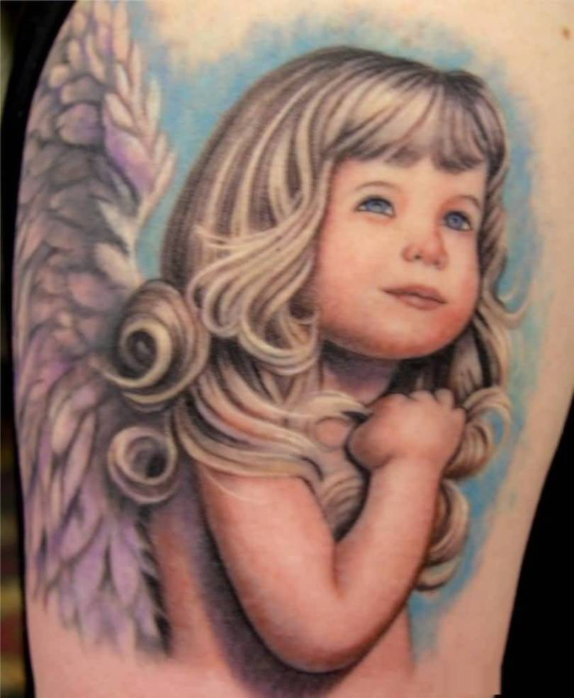 great blue and red light color ink baby angel tattoo on boy leg for boys made by expert