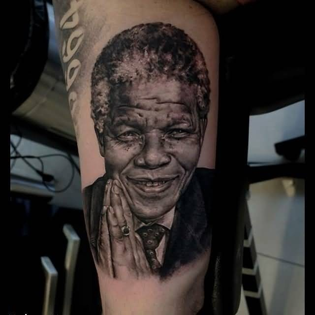 Horrible Gray And Black Color Ink African President Tattoo On Boy Body
