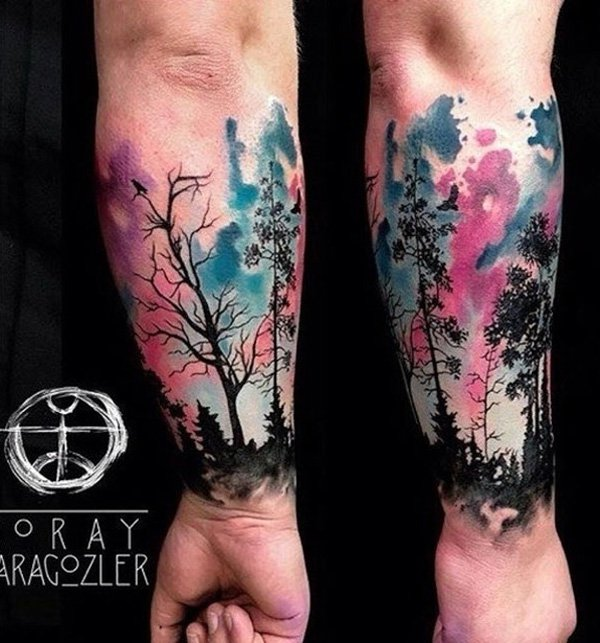 incredible Watercolor Forest Tattoo on Wtist by Koray Karagozler With colourful ink For Man And Woman