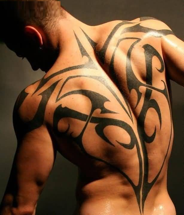 Incredible Gray Color Ink Tribal Tattoo On Men Back