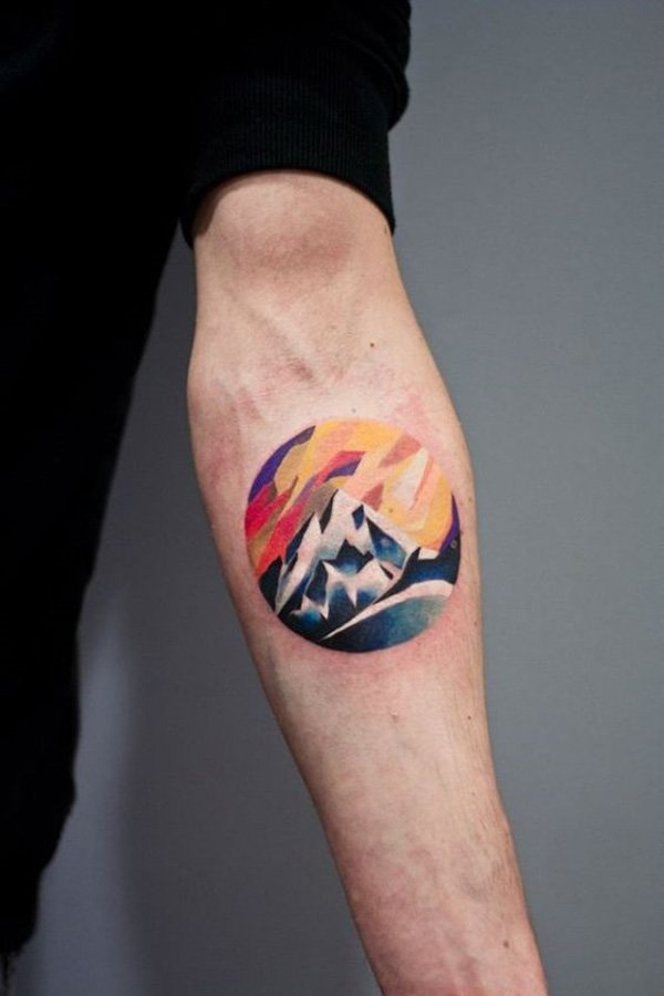 incredible mountain tattoo on wrist With colourful ink For Man And Woman