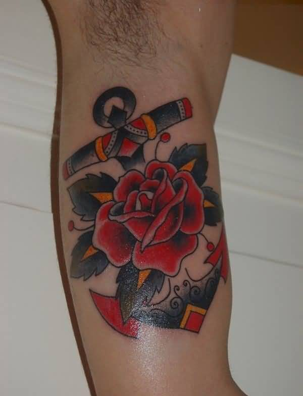 incredible red yellow and black color ink anchor tattoo on boy sleeve made for man