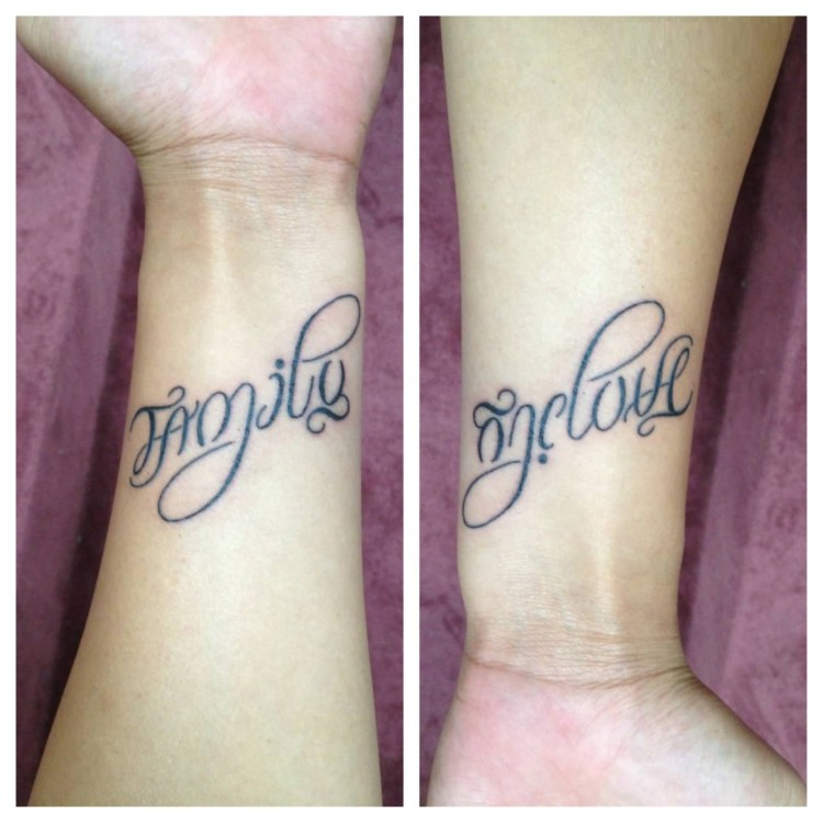 inspirational gray color ink ambigram family tattoo on wrist only for girls