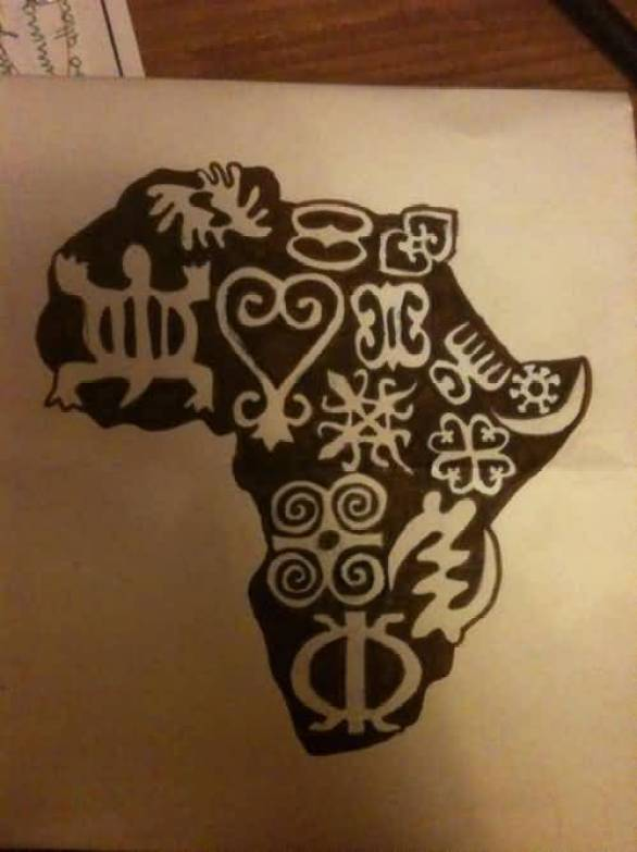 Lovely Black Ink African Symbol Tattoo On Paper