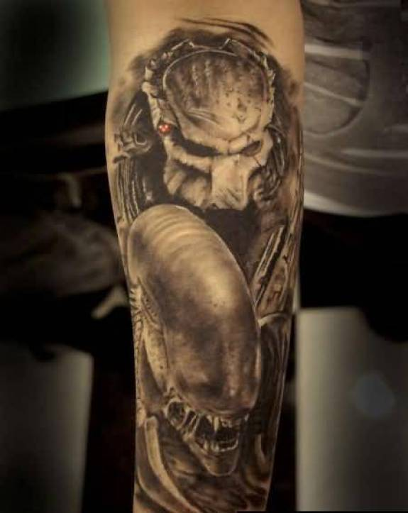 Lovely Golden Color Ink Alien Tattoo On Arm Made For Man