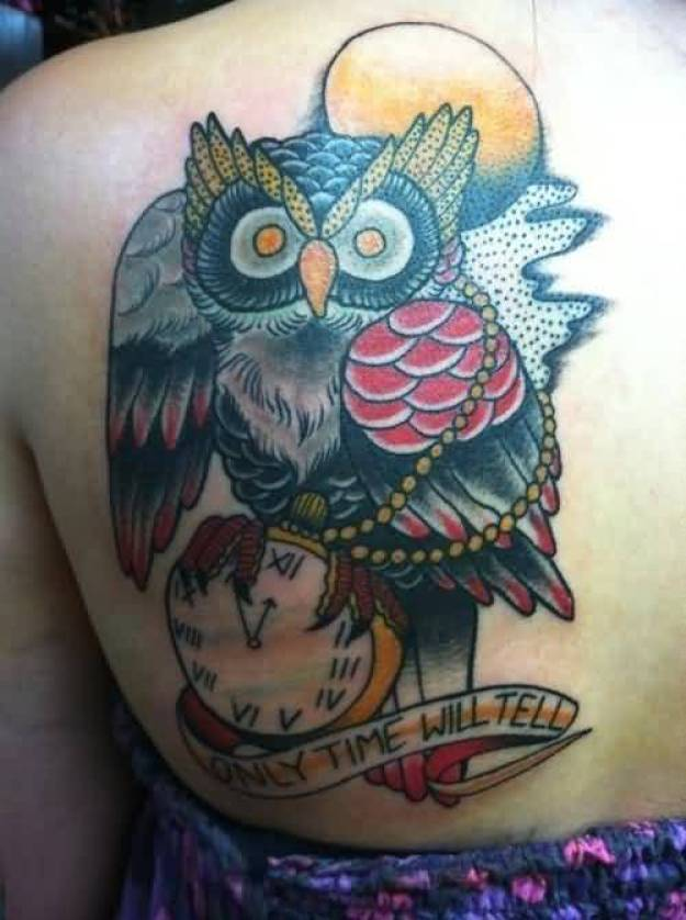 lovely red yellow and black color ink animated owl tattoo on girl's back for girls only made by expert