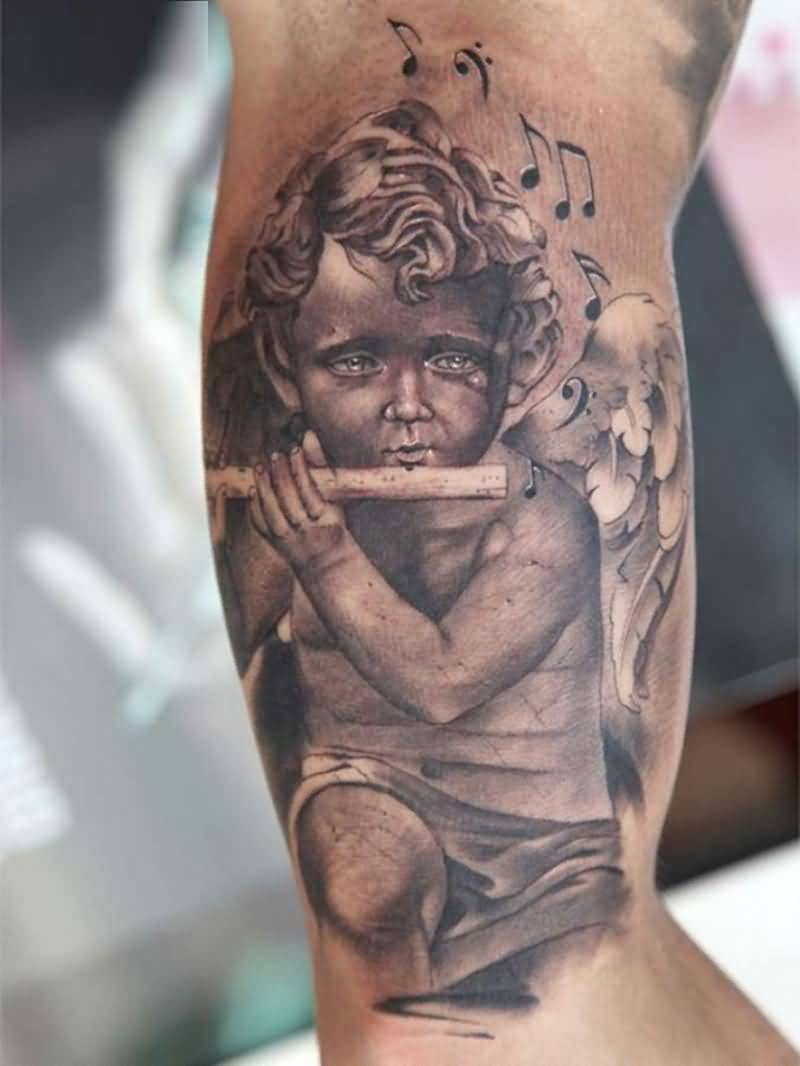 marvelous gray color ink baby angel tattoo on boy arm for boys made by expert