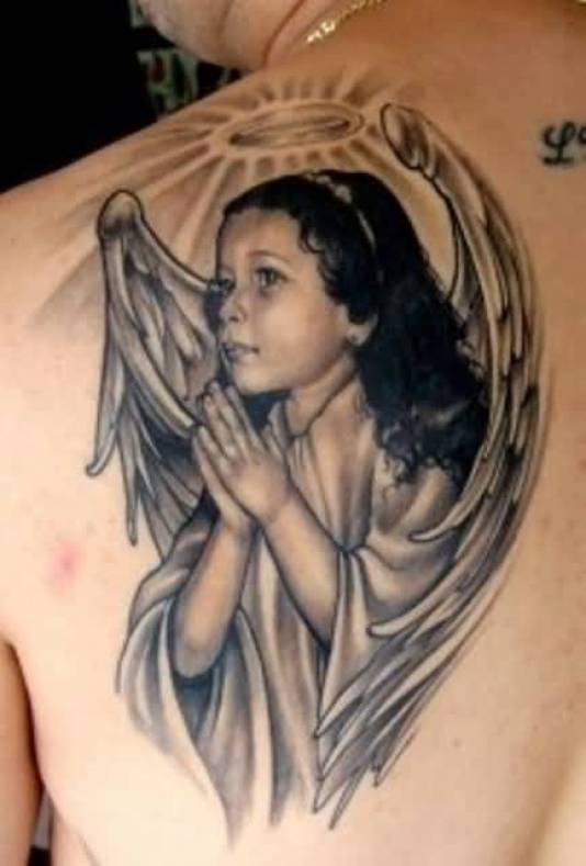 mind blowing blue and black color ink baby angel tattoo on boy on shoulder made by expert