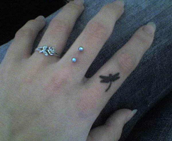 Most Amazing Dragonfly Finger Tattoo With Black Ink For Man And Woman