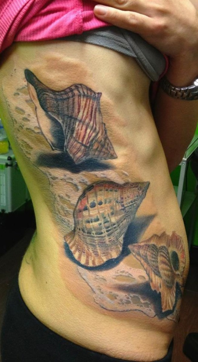 most amazing shell tattoo on side With Colouerful ink For Man And Woman